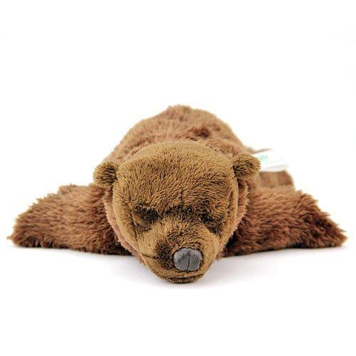 Realistic stuffed brown bear child sleeping