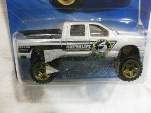 Die-cast 2006 Super Lift Dodge Ram 1500 w HW Performance truck bed opens in a 164 scale truck by HotWheels
