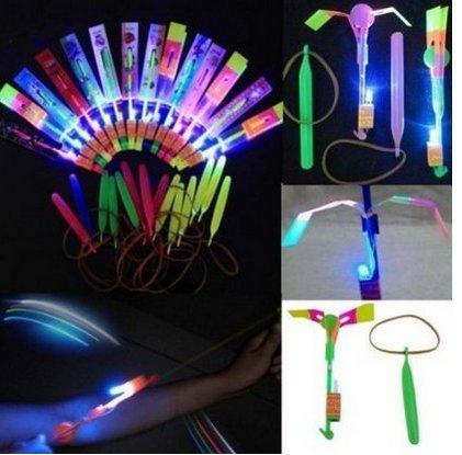 Happyi 8pcs Amazing Led Light Arrow Rocket Helicopter Flying Toy Party Fun Gift Elastic