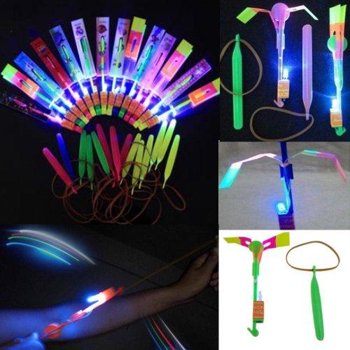 Tzou 12pc Amazing Led Light Arrow Rocket Helicopter Flying Toy Party Fun Gift Elastic